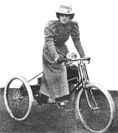 Mlle Serpolette on her motor tricycle
